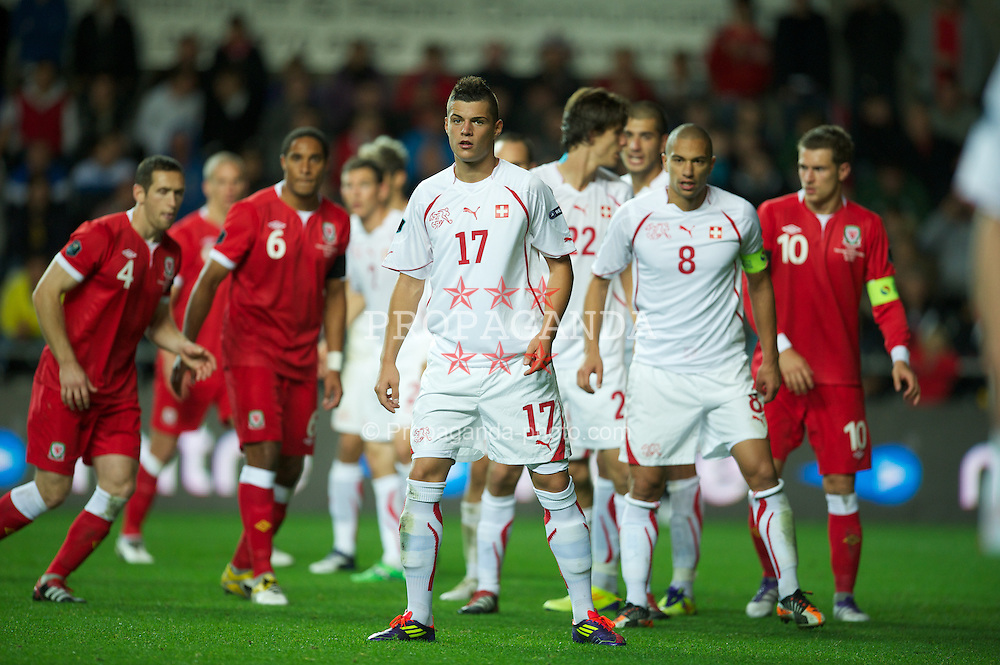 SWANSEA, WALES - Friday, October 7, 2011: Switzerland's Granit Xhaka in action against Wales during the UEFA Euro 2012 Qualifying Group G match at the Liberty Stadium. (Pic by David Rawcliffe/Propaganda)