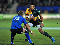 Luther Burrell (Northampton) faces off against Ian Madigan (Leinster) - Photo mandatory by-line: Patrick Khachfe/JMP - Tel: Mobile: 07966 386802 07/12/2013 - SPORT - RUGBY UNION -  Franklin's Gardens, Northampton - Northampton Saints v Leinster - Heineken Cup.