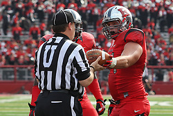 Sept 8, 2012; Piscataway, NJ, USA; Rutgers Scarlet Knights defensive tackle Scott Vallone (94) hands the ball to the referee after his fumble recovery during the first half at High Point Solutions Stadium.