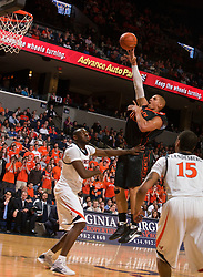 Miami (FL) forward Jimmy Graham (00) shoot a jump shot over Virginia center Tunji Soroye (21).  The Virginia Cavaliers fell to the Miami Hurricanes 62-55 at the John Paul Jones Arena on the Grounds of the University of Virginia in Charlottesville, VA on February 26, 2009.