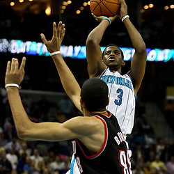 March 30, 2011; New Orleans, LA, USA; New Orleans Hornets point guard Chris Paul (3) shoots over Portland Trail Blazers point guard Patrick Mills (8) during the first half at the New Orleans Arena.    Mandatory Credit: Derick E. Hingle