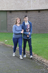 Teenage couple walking arm in arm
