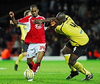 Photo: Leigh Quinnell/Sportsbeat Images.<br /> Watford v Bristol City. Coca Cola Championship. 01/12/2007. Bristol Citys Darren Byfield looks for a way past Watfords Dan Shittu.