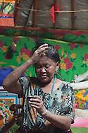 Mongolia. Ulaanbaatar. Mme Tserendolgor,  master shaman  drinking vodka  . Ulaan baatar