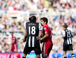NEWCASTLE-UPON-TYNE, ENGLAND - Sunday, April 1, 2012: Liverpool's Luis Alberto Suarez Diaz talks with Newcastle United's captain Jonas Gutierrez during the Premiership match at St James' Park. (Pic by Vegard Grott/Propaganda)