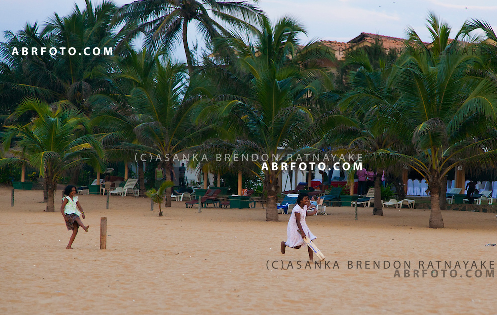 Girls playing beach cricket with palm trees in the backgroundNegombo is a major city in Sri Lanka, located on the west coast of the island and at the mouth of the Negombo Lagoon