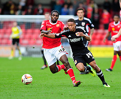 Bristol City's Bobby Reid jostles for the ball with Crewe Alexandra's Anthony Grant - Photo mandatory by-line: Dougie Allward/JMP - Tel: Mobile: 07966 386802 19/10/2013 - SPORT - FOOTBALL - Alexandra Stadium - Crewe - Crewe V Bristol City - Sky Bet League One