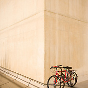 Bicycle in the shadows leaning against the wall of a building