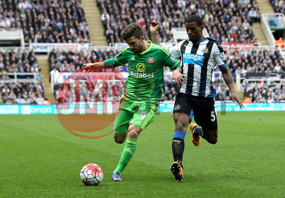 Fabio Borini of Sunderland and Georginio Wijnaldum of Newcastle United challenge for the ball - Mandatory byline: Robbie Stephenson/JMP - 20/03/2016 - FOOTBALL - ST James Park - Newcastle, England - Newcastle United v Sunderland - Barclays Premier League