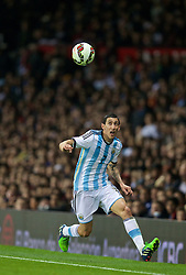 MANCHESTER, ENGLAND - Tuesday, November 18, 2014: Argentina's Angel Di Maria in action against Portugal during the International Friendly match at Old Trafford. (Pic by David Rawcliffe/Propaganda)