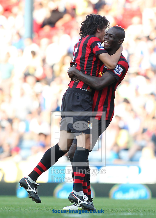 Picture by MIchael Sedgwick/Focus Images Ltd. 07900 363072.1/10/11.Mario Balotelli celebrates with Stefan Savic scorer of the fourth Manchester City goal against Blackburn Rovers during the Barclays Premier League match at Ewood Park stadium, Blackburn, Lancashire.