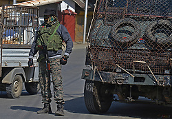 October 7, 2018 - Srinagar, Jammu and Kashmir, India - An Indian policeman of Special Operation Group (SOG) stands alert outside the polling station during first phase of Urban Local Bodies (ULB) elections in Srinagar the summer capital  Indian controlled Kashmir on October 8, 2018. A complete shutdown is being observed across Kashmir valley following the call of shutdown and election bycott by Kashmiri separatist leaders which began on October 8. (Credit Image: © Faisal KhanZUMA Wire)