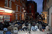 London 04/01/09: Protests outside the Israeli Embassy in London UK: Evening prayers were held in the street