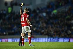 Bristol City's Nathan Baker receives a yellow card - Mandatory byline: Jason Brown/JMP - 07966 386802 - 20/10/2015 - FOOTBALL - American Express Community Stadium - Brighton,  England - Brighton & Hove Albion v Bristol City - Championship