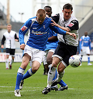 Photo: Paul Thomas.<br /> Preston North End v Birmingham City. Coca Cola Championship. 06/05/2007.<br /> <br /> David Nugent (R) of Preston battles with Sebastien Larsson.