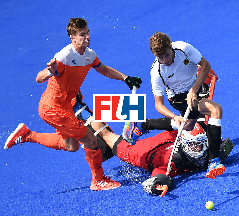 Netherlands' Sander de Wijin (L) vies with Germany's Florian Fuchs (R) as Netherlands' goalkeeper Jaap Stockmann lies on the pitch during the men's Bronze medal field hockey Netherlands vs Germany match of the Rio 2016 Olympics Games at the Olympic Hockey Centre in Rio de Janeiro on August 18, 2016. / AFP / MANAN VATSYAYANA        (Photo credit should read MANAN VATSYAYANA/AFP/Getty Images)