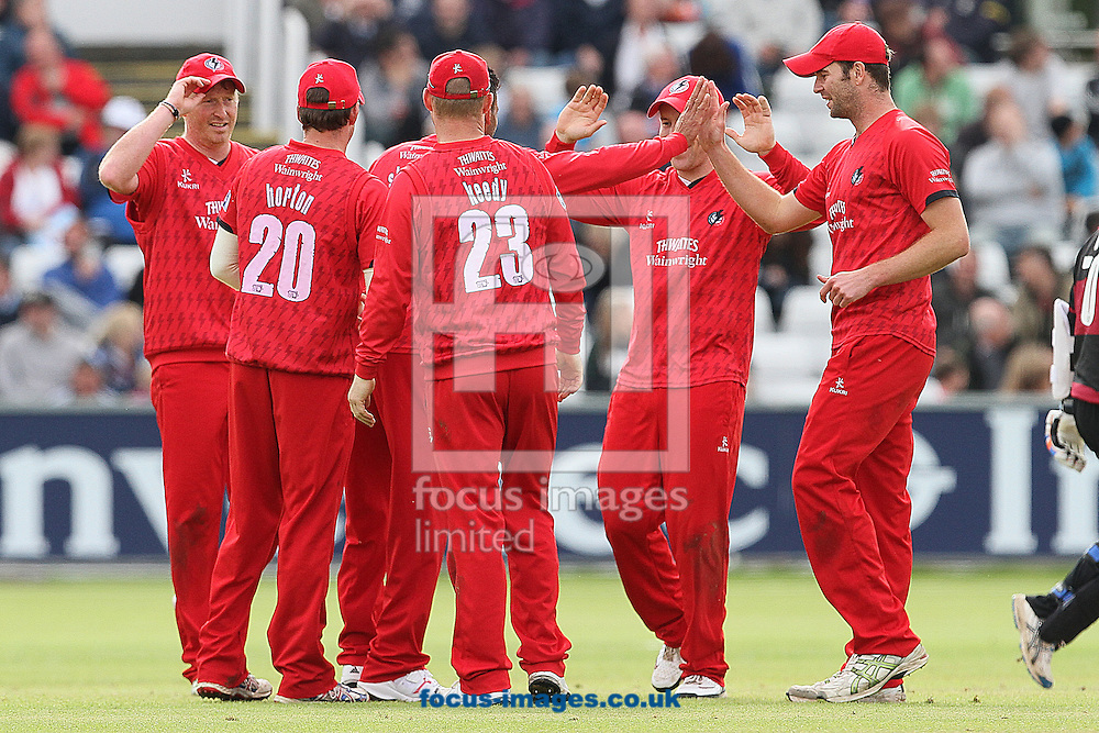 Picture by Mark Fletcher/Focus Images Ltd. 0775 2571576.08/07/12.Lancashire Lightning celebrate after Dale Benkenstein of Durham Dynamos is caught and bowled by Ajmal Shahzad during the FL t20 match at Emirates Durham ICG, Chester-le-Street, County Durham.