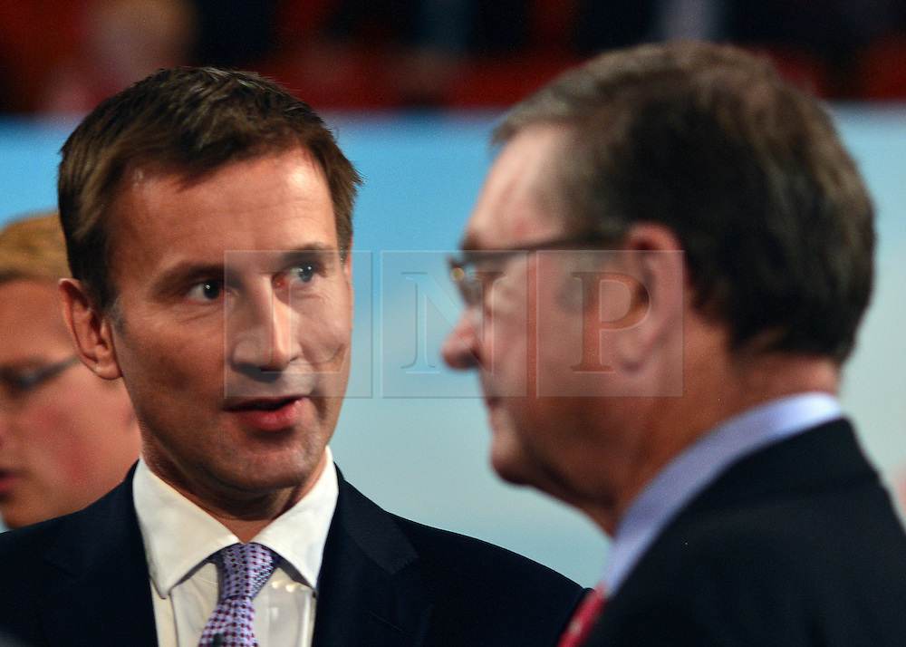 © Licensed to London News Pictures. 09/10/2012. Birmingham, UK Jeremy Hunt talks to Lord Ashcroft at The Conservative Party Conference at the ICC today 9th October 2012. Photo credit : Stephen Simpson/LNP