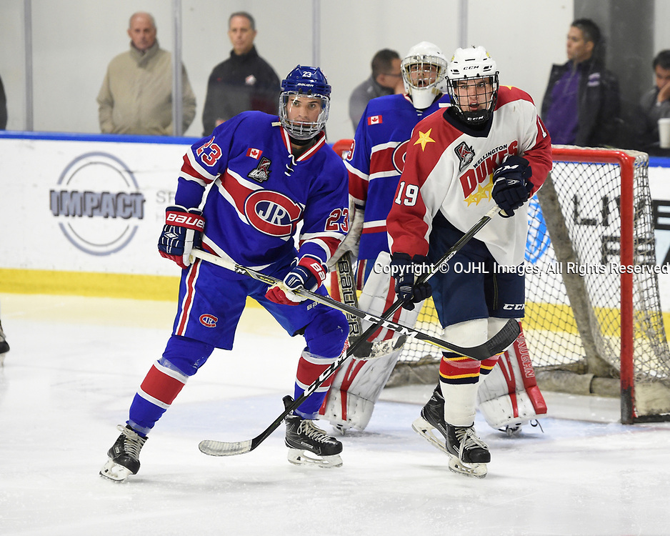 BUFFALO, NY - SEP 20,  2017: Ontario Junior Hockey League Governors Showcase game between the Toronto Jr. Canadiens and Wellington Dukes, Jordan Kreller #23 of the Toronto Jr. Canadiens protects the crease from Jeffrey Burridge #19 of the Wellington Dukes during the third period.<br /> (Photo by Andy Corneau / OJHL Images)