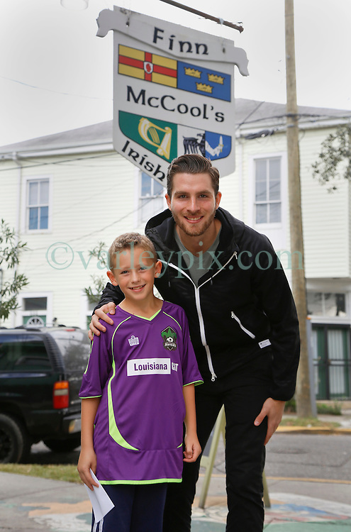23 November 2015. Finn McCool's Irish Pub, New Orleans, Louisiana.<br /> Major League Soccer (MLS) star player Patrick Mullins of New York City FC poses for a photo with Ben.<br /> Photo&copy;; Charlie Varley/varleypix.com