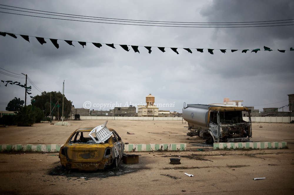Relics of cars burnt during clashes between Gheddafi militia and anti government protesters are seen on February, 25 2011 outside the militia headquarter in Benghazi, Libya..ALESSIO ROMENZI
