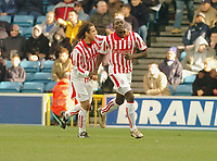 Photo. Leigh Quinnell.  Millwall v Stoke City Coca Cola championship. 19/02/2005. Stokes Darel Russell congratulates Gifton Noel-Williams on his goal.