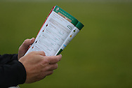 Plumpton, UK. 12th December 2016. <br /> A punter reads his race card prior to the Crawley Town Football Club Handicap Chase<br /> &copy; Telephoto Images / Alamy Live News
