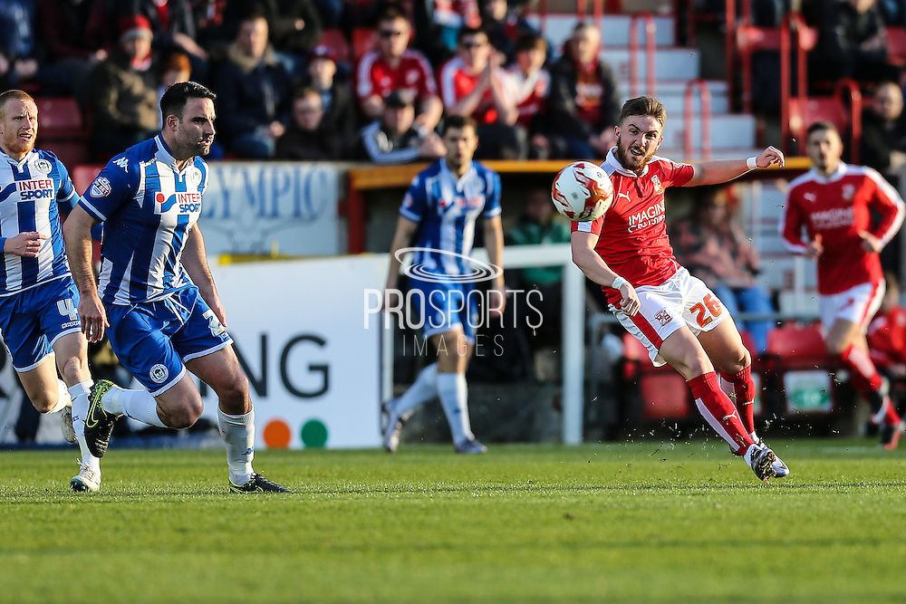 Swindon midfielder Anton Rodgers makes a pass during the Sky Bet League 1 match between Swindon Town and Wigan Athletic at the County Ground, Swindon, England on 25 March 2016. Photo by Shane Healey.