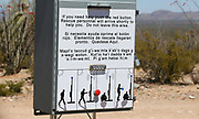 A sign written in English, Spanish and O'odham is seen at a rescue station near the U.S. - Mexico border on the Tohono O'odham reservation in Chukut Kuk, Arizona April 6, 2017. Picture taken April 6, 2017.  REUTERS/Rick Wilking