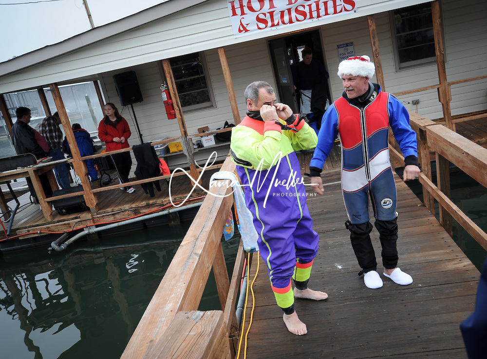 01/01/2011 Sherrills Ford, NC - (lft-rt) Russ Frase of Tega Cay and Danny Richardson of Kernersville suit up for the Barefoot Challenge..     The 33rd Annual Lake Norman New Years Day Barefoot Challenge began  just after noon Saturday, despite a morning fog that blanketed the lake. The fog obligingly lifted as they took the towboat on a test run, looping by the Lake Norman Marina. photo © Laura Mueller - www.lauramuellerphotography.com