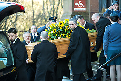 © Licensed to London News Pictures. 28/03/2018. Liverpool, UK. Ken Dodd's coffin is carried away from Liverpool Cathedral after the service . The funeral of comedian and performer Sir Ken Dodd , who died on 11th March 2018 at the age of 90 . Photo credit: Joel Goodman/LNP