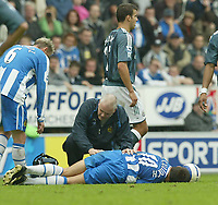 Photo: Aidan Ellis.<br /> Wigan Athletic v Newcastle United. The Barclays Premiership. 15/10/2005.<br /> wigan's lee McCulloch lays injured after his challenge on Newcastle's Emre for which he was sent off
