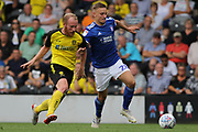 Burton Albion forward Liam Boyce and Ipswich Town defender Luke Woolfenden challenge for the ball during the EFL Sky Bet League 1 match between Burton Albion and Ipswich Town at the Pirelli Stadium, Burton upon Trent, England on 3 August 2019.