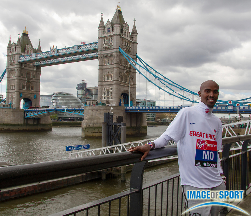 Apr 8, 2014, London, United Kingdom; Mo Farah (GBR) poses by the Tower Bridge and Thames River in advance of the 2014 Virgin Money London Marathon. Photo by Jiro Mochizuki
