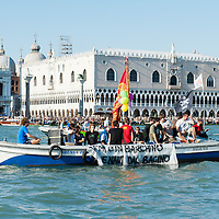 Environmentalists, Protesters and Venetian Citizen organise  a march with with hundreds of small booths to say No to Big Ships in St Mark's Basin. The cruise traffic has been delayed for several hours