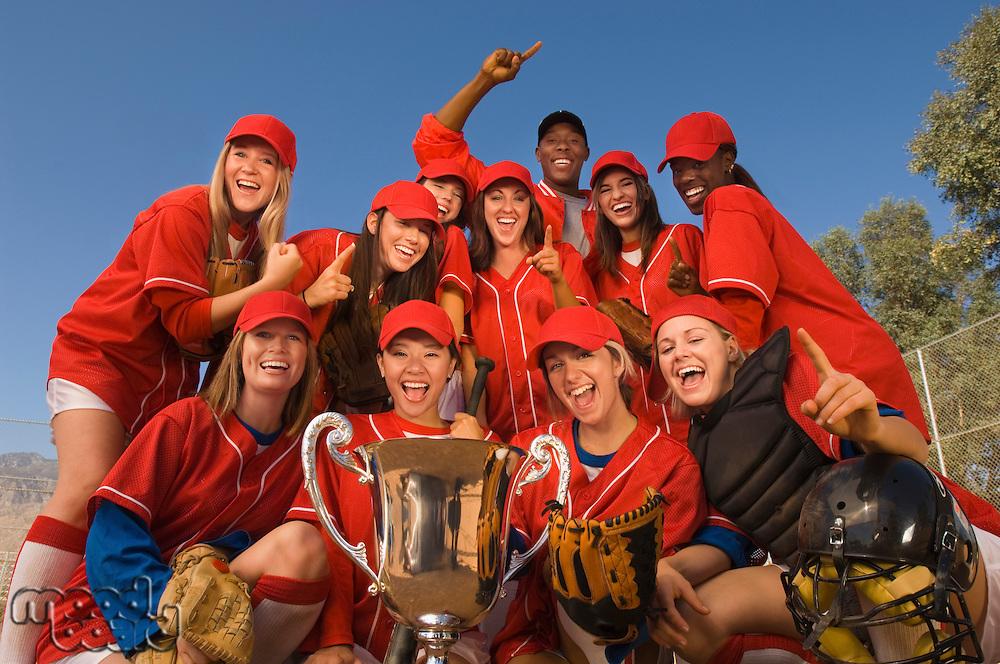 Women's softball team with trophy portrait