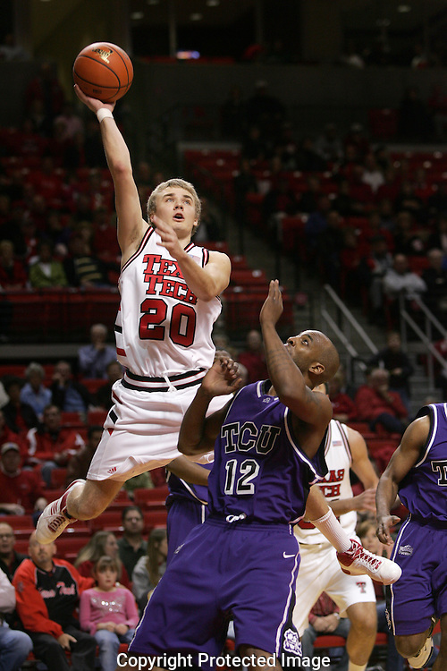 Jodi Miller Lubbock Avalanche-Journal.Tech's Alan Voskuil (20) goes upover Brent Hachett (12) to tip a shot.
