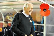Eastleigh manager Ronnie Moore walking past a giant poppy on the home dugout before the The FA Cup match between Eastleigh and Swindon Town at Arena Stadium, Eastleigh, United Kingdom on 4 November 2016. Photo by Graham Hunt.