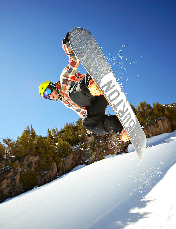 A freestyle snowboarder catches air in the halfpipe at Mammoth Mountain Ski Area, California.