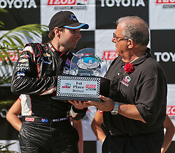 LONG BEACH, CA - APR 15: IndyCar Series driver Will Power receives first place trophy from the city of Long Beach Mayor Bob Foster after winning the 2012 Toyota Grand Prix of Long Beach. All fees must be ageed prior to publication,.Byline and/or web usage link must  read SILVEX.PHOTOSHELTER.COM Photo by Eduardo E. Silva