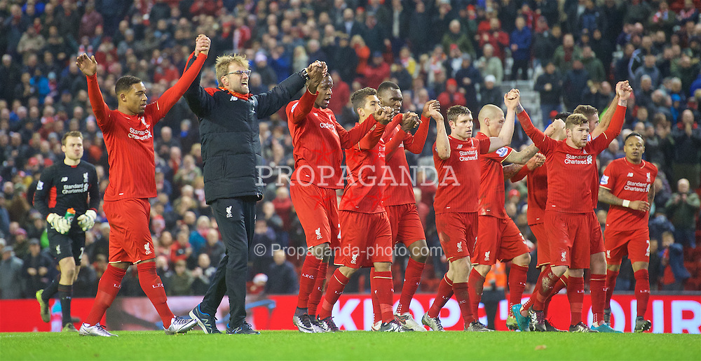 LIVERPOOL, ENGLAND - Sunday, December 13, 2015: Liverpool's manager Jürgen Klopp and the players salute the supporters after the 2-2 draw against West Bromwich Albion in the Premier League at Anfield. (Pic by James Maloney/Propaganda)