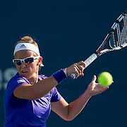 August 16, 2014, New Haven, CT:<br /> Kirsten Flipkens hits a forehand during a match against Misaki Doi on day four of the 2014 Connecticut Open at the Yale University Tennis Center in New Haven, Connecticut Monday, August 18, 2014.<br /> (Photo by Billie Weiss/Connecticut Open)