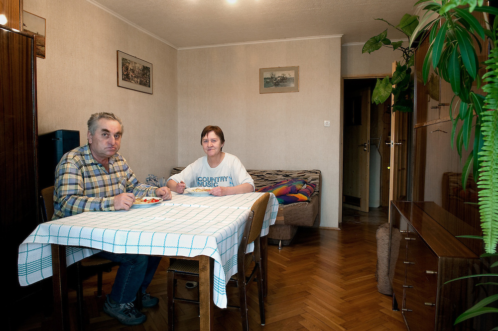 Danuta 65, Władysław 65<br /> <br /> Nowa Huta, Krak&oacute;w, Poland  low income, higher education <br /> <br /> Both we are pensioners now. Danuta used to work as an accountant in Krak&oacute;w and Władysław was an engineer in a building company. <br /> <br /> We eat together everyday it is our routine. Sometimes our son comes after work here for some food. When we were working we were coming home different times so we couldn&rsquo;t eat together. Probably the most important thing for a good meal is to give satisfaction to the people you cook for. On Sundays when we have our children around is a big celebration we spend more time on the table. We have a plot and in the summer we go there very often and we have BBQ&rsquo;s. In the plot we cultivate flowers, beans, onions, tomatoes, cucumbers etc. we spend all day there, it&rsquo;s beautiful. In the old days the factories owned those plots and giving them for free to the workers. Now we have to pay a small rent but it is worth it.