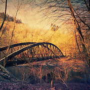Abandoned railway bridge over river Wupper / Germany. Vintage processing with textures.<br />