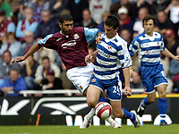 Photo: Olly Greenwood.<br />West Ham United v Reading. The Barclays Premiership. 01/10/2006. West Ham's Hayden Mullins and Reading's Shane Long