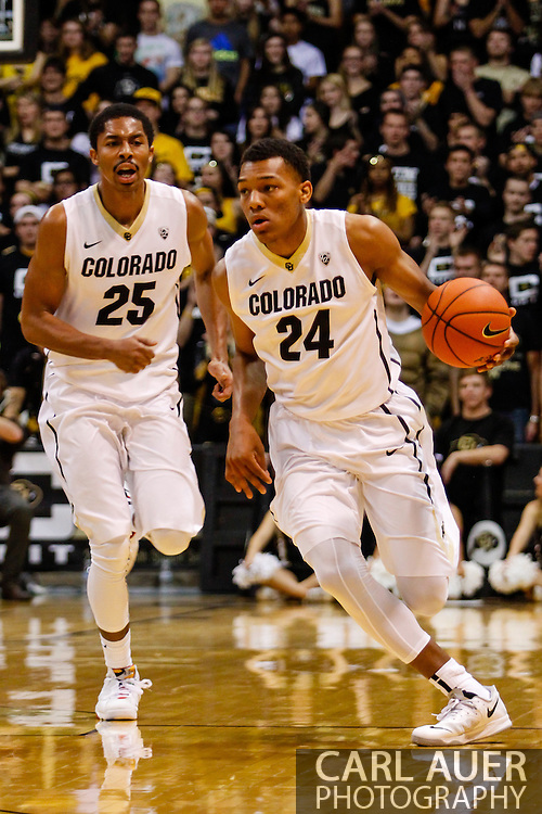 November 16th, 2013:  Colorado Buffaloes freshman guard/forward George King (24) hurries the ball up court past teammate junior guard Spencer Dinwiddie (25) in the second half of the NCAA Basketball game between the Jackson State Tigers and the University of Colorado Buffaloes at the Coors Events Center in Boulder, Colorado