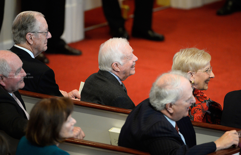 Former Georgia governors Sonny Perdue, Joe Frank Harris, President Jimmy Carter and Roy Barnes, from left to right, smile as they reminisce during a memorial service for Georgia Gov. Carl Sanders at Second Ponce de Leon Baptist Church on Saturday, Nov. 22, 2014, in Atlanta. Photo by David Tulis