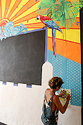 painting a mural, Cartagena, Colombia