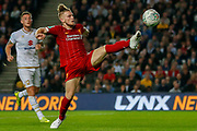 Liverpool midfielder Harvey Elliott (67) stretching to control the ball during the EFL Cup match between Milton Keynes Dons and Liverpool at stadium:mk, Milton Keynes, England on 25 September 2019.