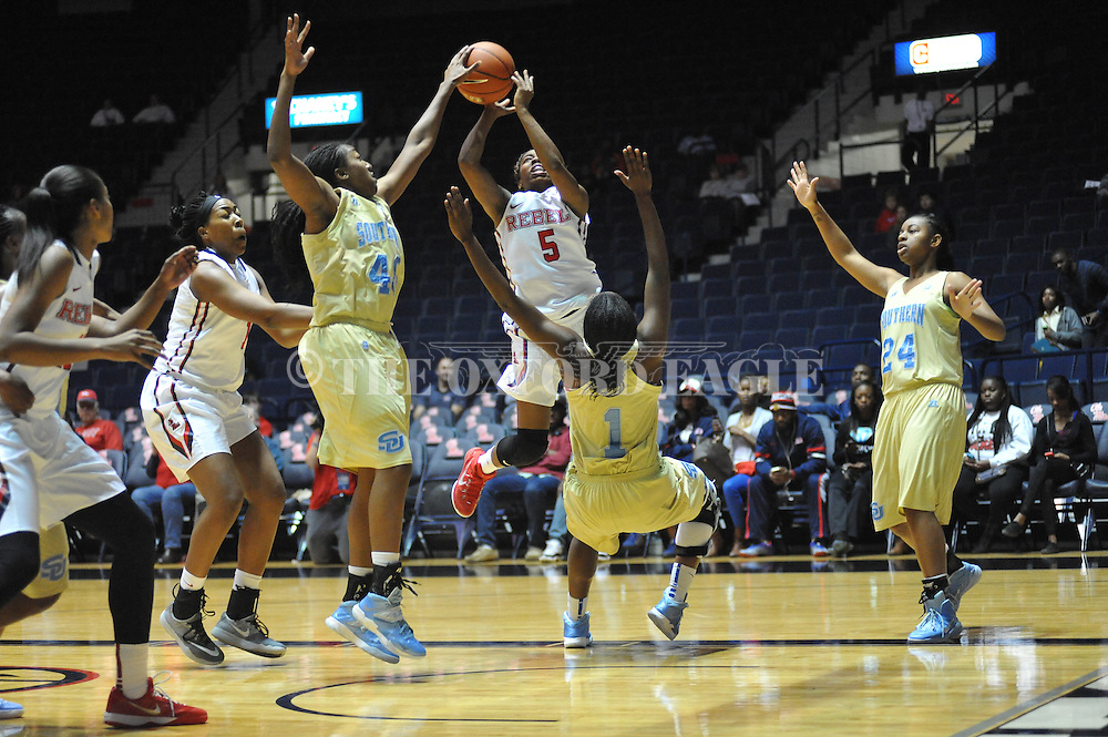 "Ole Miss guard Erika Sisk (5) is fouled by Southern University Jaguars guard Briana Green (1) as Southern University Jaguars guard Cortnei Purnell (40) and Southern University Jaguars guard Micah Garvin (24) defend at the C.M. ""Tad"" Smith Coliseum in Oxford, Miss. on Thursday, November 20, 2014. (AP Photo/Oxford Eagle, Bruce Newman)"